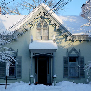 Snow Covered Light Green House