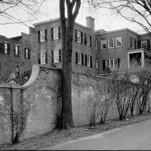 Stone wall behind mansion