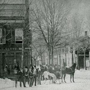 People gathered around horse carriage
