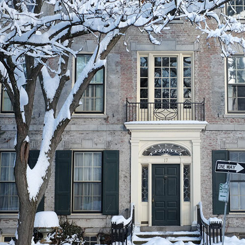 brick house in snow