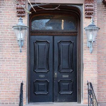 Black door brick house