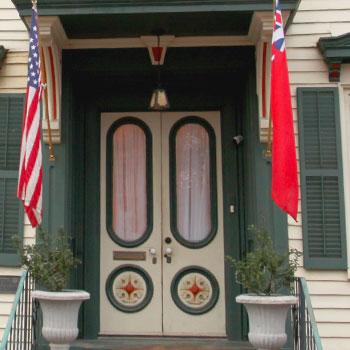 cream door flags green trim