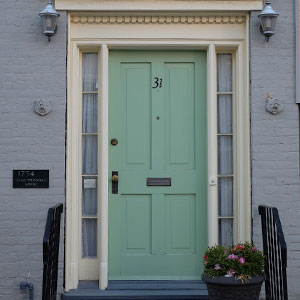 green door on a painted brick house