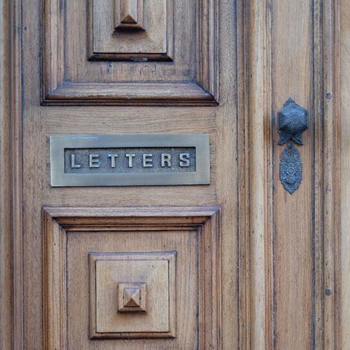 letter slot on wooden door