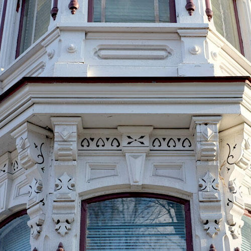 ornate white painted window bumpout