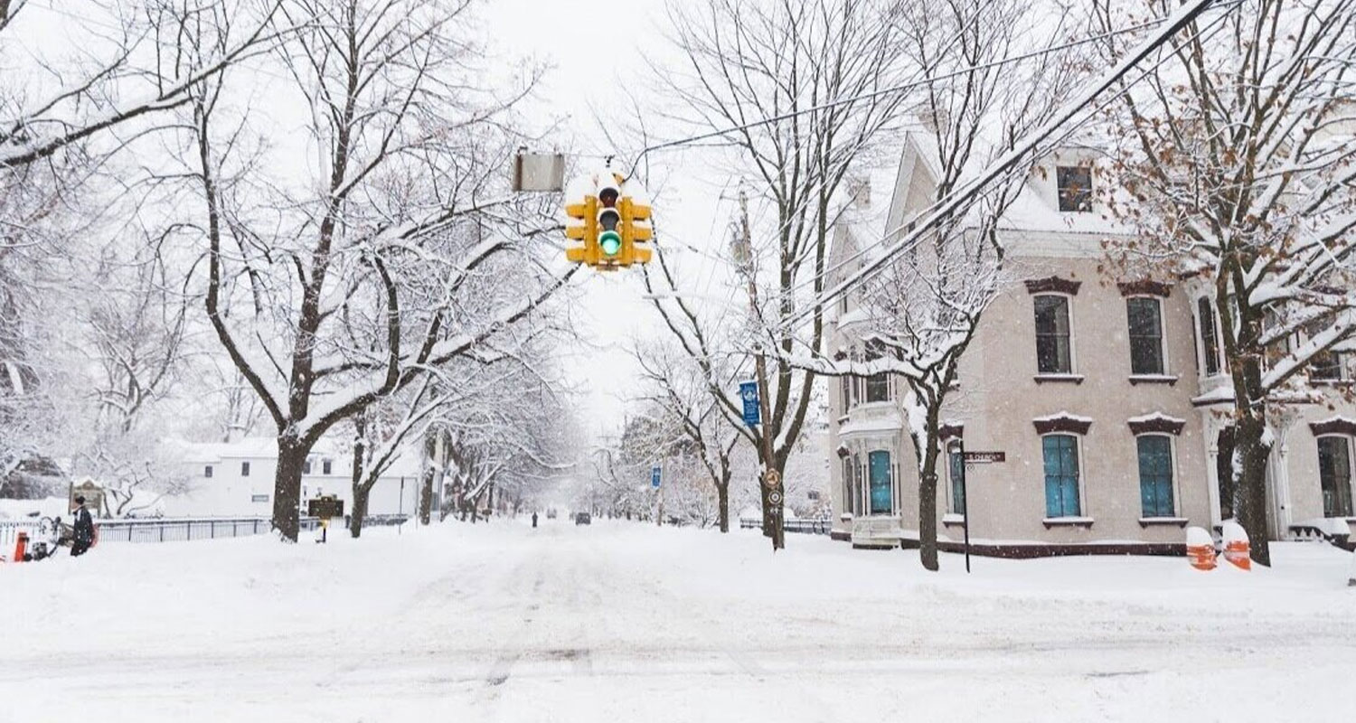 snow covered streets with traffic light